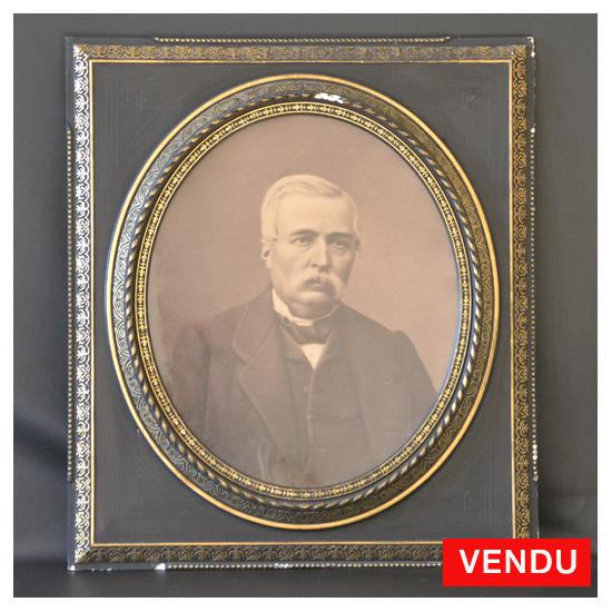 Encadrement 76X86 cm Napoléon III en bois noirci à vue ovale